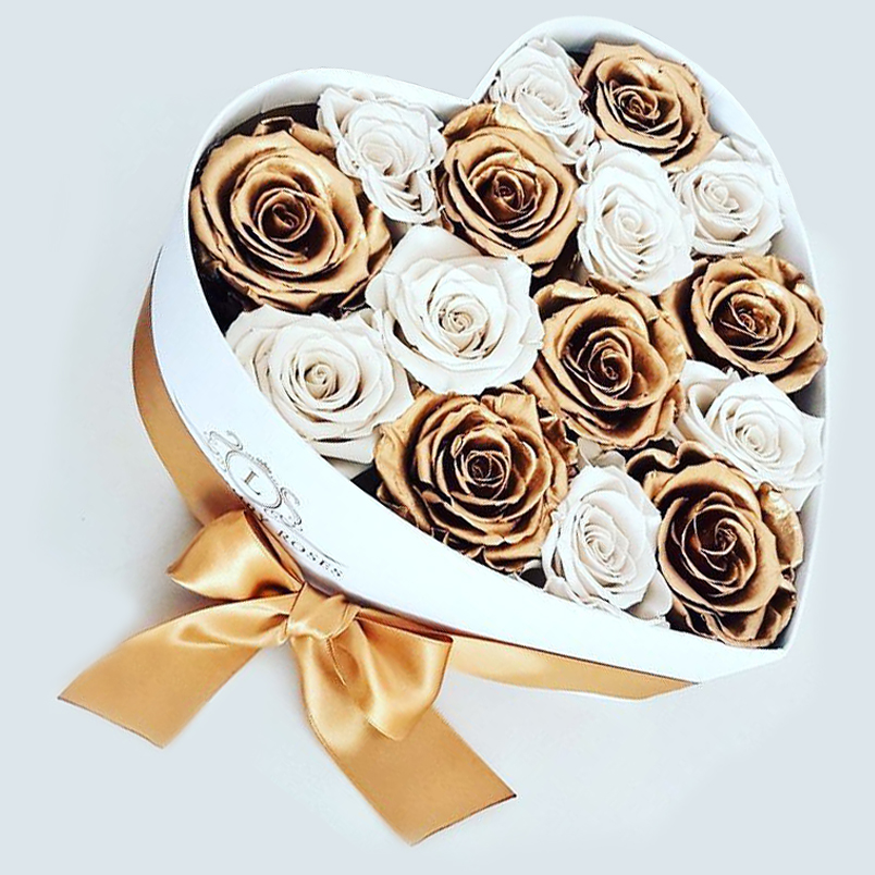 Heartshaped box with a mix of white and gold roses