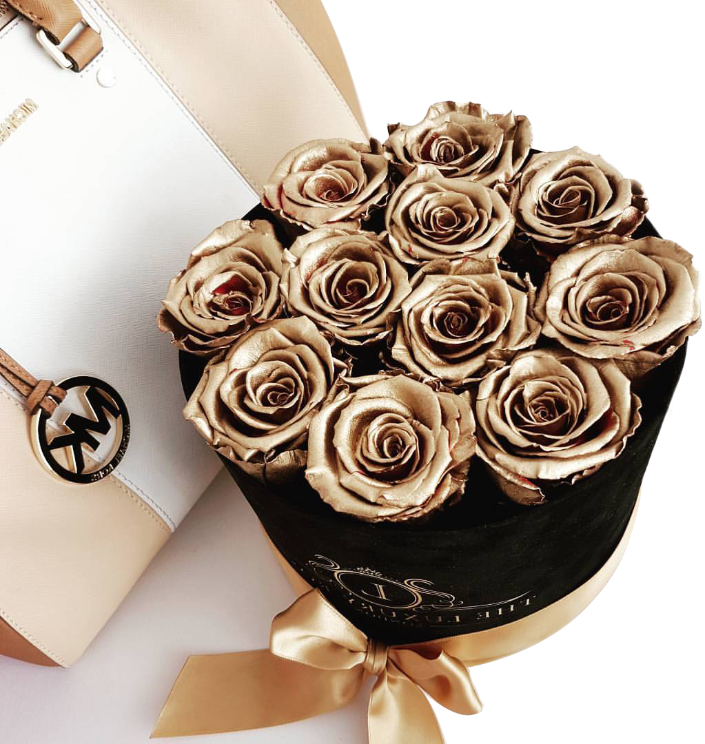 Golden roses in a black cylinder box